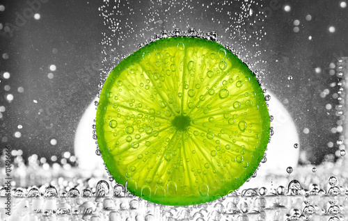 Cut lime in the water - 111496666
