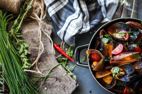 Saucepan with steamed mussels Poster