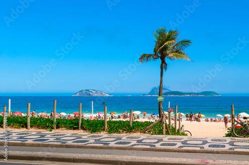 Ipanema beach with mosaic of sidewalk in Rio de Janeiro. Brazil Poster