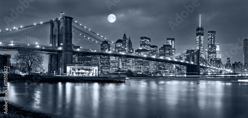 Night panorama of of New York City with the moon in the sky - fototapety na wymiar