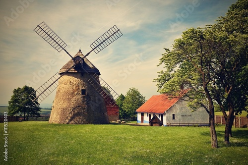 Old windmill - Czech Republic Europe. Beautiful old traditional mill house with a garden. Kuzelov - South Moravia.