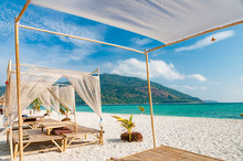 Relax On A Luxury VIP Beach With Nice Pavilions In A Sunshine Blue Sky