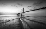 Vasco da Gama bridge at black and white, sunrise Lisbon