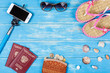 The concept of a beach holiday. Beach accessories lying on a blue wooden background.
