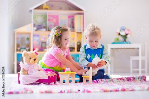 Fotografie, Obraz  Kids playing with stuffed animals and doll house