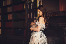 Elegant Young Woman In Dress A...