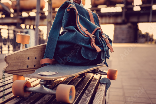 Fotografie, Obraz  Longboard with backpack on it.