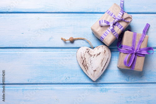 Two festive gift boxes with presents and decorative heart