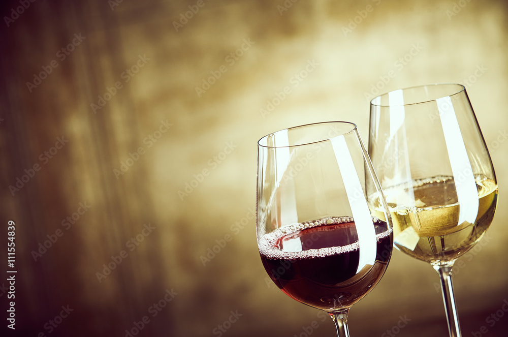 Wineglasses of red and white wine side by side