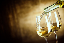 Pouring Two Glasses Of White W...