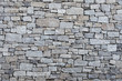 Old grey stone wall background texture
