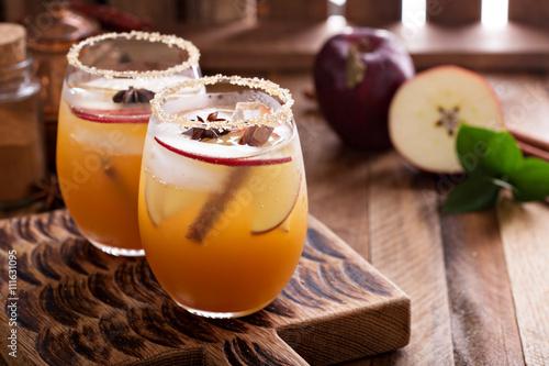 Fototapeta Apple cider cocktail with cinnamon obraz