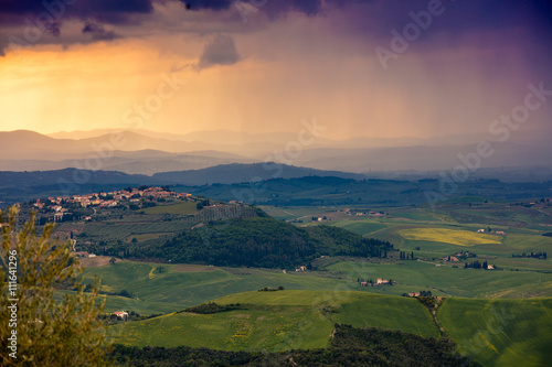 Fotografie, Obraz  Tuscany valley in stormy weather at sunset, Italy