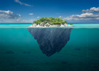Beautiful solitude island with green trees in the ocean