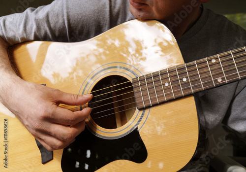 Fotografia, Obraz  Man playing acoustic guitar
