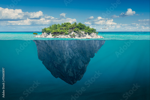 Idyllic solitude island with green trees in the ocean