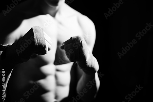 Black white photography of athlete with tape on the hand Canvas Print