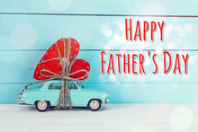 Fathers Day Background With Miniature Blue Toy Car Carrying A He
