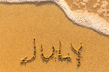 July - Inscription On Sand Beach With The Soft Wave...