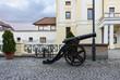 Downtown pedestrian street with a cannon near castle, in Sibiu with dark sky, Romania