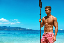Summer Water Sport. Man With Canoe Kayak Paddle On Beach