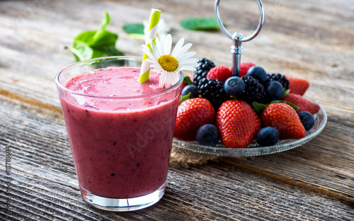 Ingelijste posters Milkshake Summer berries smoothie on rustic wooden background