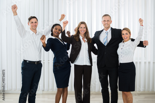 Fototapety, obrazy: Successful Businesspeople Raising Hands