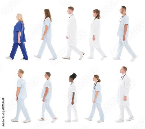 Valokuva  Medical Team Walking In Row