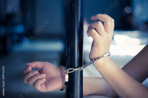 Fotografie, Obraz  Lady with handcuff on bed, Human trafficking - Concept Photo
