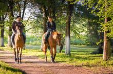 Young Couple  Riding A Horse