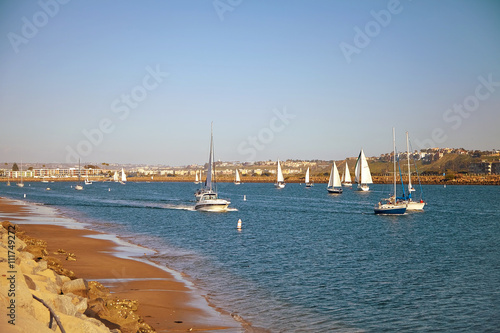 Photo  Sailboats back to the Marina Del Rey in California