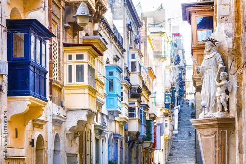 Valokuva  Typical narrow streets with colorful balconies in Valletta , Malta