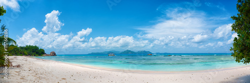 Photo Stands Tropical beach panoramic view of tropical anse severe beach on la digue island in seychelles
