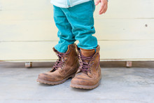 Baby Boy Try To  Wearing Father's Boots