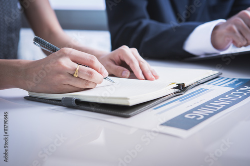 Fototapety, obrazy: Business adviser analyzing financial figures denoting the progre
