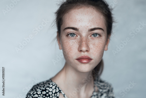 Fotografie, Obraz  beautiful young girl with freckles close-up