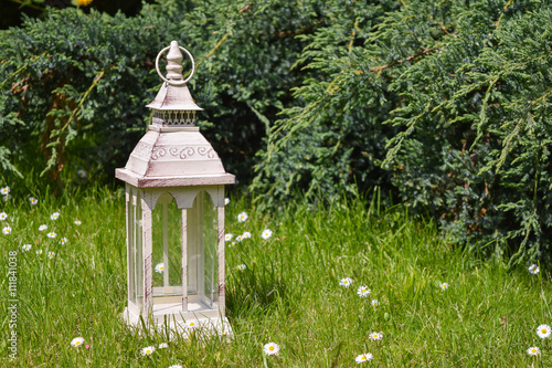 lantern on grass in vintage style Poster