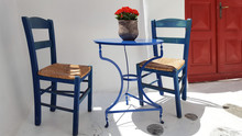 Blue Table And Chairs In Front Of Greek House