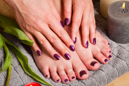 Tuinposter Pedicure Close up of woman with pedicure and manicure