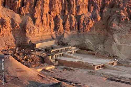 Tuinposter Egypte Egypt. Luxor. Deir el-Bahari (or Deir el-Bahri). The Mortuary Temple of Hatshepsut - aerial view in early sunlight