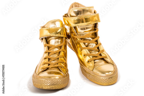 Fotografia  Pair of golden sneakers isolated