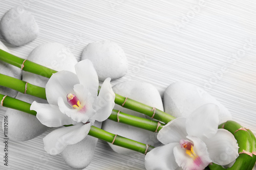 Beautiful spa composition with bamboo on light wooden background Poster