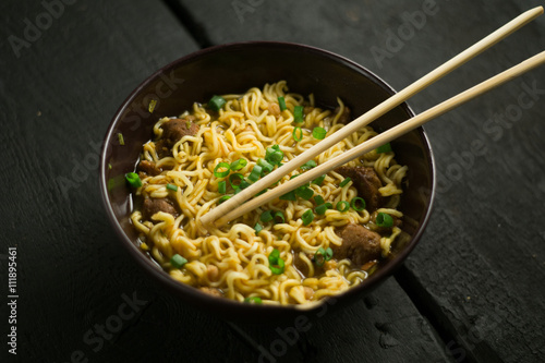 Photo  Asian quick noodles on wood background photo