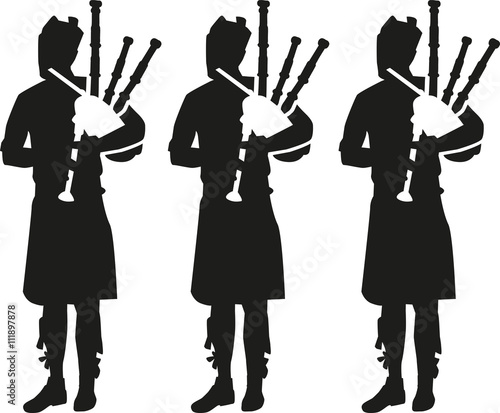 Canvas Print Three Bagpipe player silhouettes
