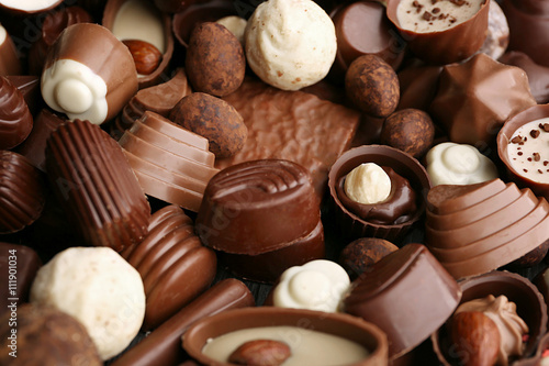 Foto op Aluminium Snoepjes Assortment of delicious chocolate candies background, close up