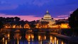 saint peter basilica illuminated at night reflection on tiber river vatican city rome italy