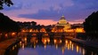 st. peter basilica and sant'angelo bridge illuminated at night reflection on tiber river vatican city rome italy
