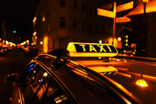 Taxi Sign On The Roof Of A Taxi