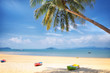 Kayak boat with coconut palm trees and tropical beach background, happy summer holiday concept