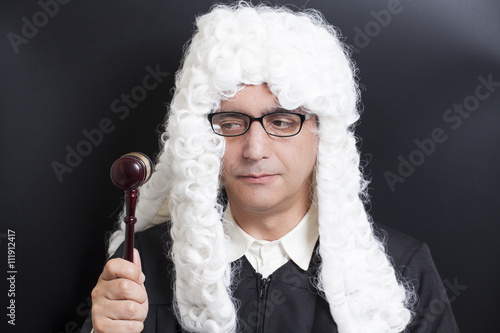 Foto  Portrait Of Male Lawyer with eyeglasses Holding Judge Gavel
